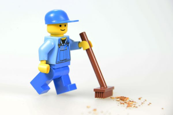 A lego man helping with commercial cleaning services.